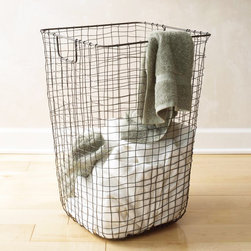 Clean Weave Hamper - The Clean Weave Hamper keeps your floors free of damp, dirty towels. Constructed from metal wire that has been delicately hand-weaved, this hamper has a rust-proof lacquer finish—perfect for the humid bathroom—and its handles will make it a cinch to carry to the laundry room for years to come.
