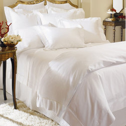 """Frontgate - Milos Fitted Sheet - Generously sized to accommodate pillow-top mattresses up to 17"""" deep. Features a classic hemstitch border. Made of the finest, longest-staple Egyptian Cotton Sateen. 100% Italian-spun into gossamer yarn. Machine wash cold using non-chlorine bleach as needed; wash dark colors separately. One touch tells you that the SFERRA Milos Bedding Collection promises a sublime sleeping experience. The finest of bed linens, Milos is woven to a magnificent 1,020 thread count using super-premium cotton sateen, resulting in an incredibly fine hand, silken shimmer, and luxurious drape.  .  .  .  .  . Tumble dry on low setting . For best results, iron on """"cotton' setting on reverse side of fabric to restore luster and sheen . Made in Italy by SFERRA. Part of the SFERRA Milos Bedding Collection."""