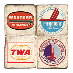 Studio Vertu - Airline Logo Coasters (Set of 4) - Celebrate the Golden Age of flying. Reminisce to the glamorous days of flying with these handmade coasters adorned with vintage airline logos. Featuring logos of Western Airlines, Piedmont Airlines, TWA, & Eastern Airlines. The coasters are handmade in a Cincinnati studio using tumbled Italian botticino marble with cork backing. Please note that due to the natural marble, any imperfections are inherent to the design and add to the natural beauty of these coasters.   About the Artist: Studio Vertu's success story began in 1995, when owner Mark Schmidt developed the concept of Lightweight Fresco Tile. Schmidt saw the product as an alternative to permanently mounted marble tiles or hand-painted mural. His insight led to Studio Vertu being awarded an installation at The National Football League Headquarters in New York City. In addition to developing large-scale installations, Schmidt wanted to bring the idea of original artwork on marble tile to homes, allowing more people to enjoy the pieces. In the spring of 1995, Studio Vertu introduced 10 sets of Italian Marble Coasters, each consisting of four different images, and a business was born. Studio Vertu continues to hand make their marble artwork in their Cincinnati-based studio. Product Details: