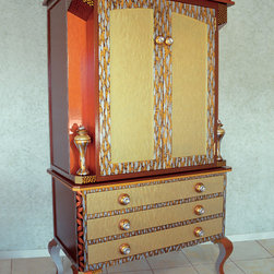 Susan Goldstick, Inc. - Diva Armoire Tigress - Constructed of alder wood, all surfaces and artwork are hand painted. Finishes are varnished with a lacquer sheen in rich jewel tone colors of light gold, copper and silver. This armoire is actually 2 pieces. The top cabinet  has 3 adjustable shelves and can also be used as a tv armoire.  All interior surfaces are finished with paint treatments. Susan Goldstick signature knobs embellish drawers and  doors while colorful cabriole legs wear a crystal.