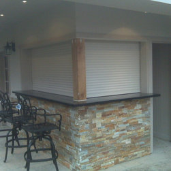 Shutters Enclosing Outdoor Kitchen and Bar - Talius Rollshutters installed to enclose and provide security to an outdoor kitchen and bar.