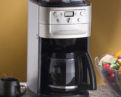 Cuisinart DGB-700BC Grind & Brew 12-Cup Automatic Coffee Maker - Sleek compact and convenient the Cuisinart Grind & Brew 12-Cup Automatic Coffeemaker provides superior coffee taste and aroma with its digital fully programmable operation and integrated burr grinder. The whole bean hopper securely seals to eradicate moisture and preserve flavor while coffee strength and grind volume options allow you to create up to 12 cups of perfect coffee brew after brew. With Cuisinart it's never been easier to make a great pot of coffee! High-Visibility LED Display with 24-Hour Clock/Timer: Have coffee ready when you wake up every morning with the Cuisinart Grind & Brew's convenient Auto-On feature. Use the Program and time buttons to program a time into the 24-hour digital clock/timer. Between the Hour and Minute Set buttons a small LCD screen displays the current time (or Auto On time) with an AM/PM indicator along with the current Strength-Control setting. An audible tone will sound when your coffee has completed the brewing cycle. Use the Auto-Off feature to automatically power the machine down at a preset time anywhere from zero to four hours after brewing is done. Six-Button/One-Dial Control Panel: Six useful buttons allow you to set time 12/24-hour display grind volume grinder power and brew strength. The grind control dial can be adjusted to one of six volume settings from two (grinds enough for two cups of coffee) to 12 (grinds enough for 12 cups of coffee). Use the Grind-Off button when using pre-ground coffee. To adjust brew strength simply press the Strength-Control button until your preferred strength (Mild Medium or Strong) is displayed on the LCD screen. 8-Ounce Bean Hopper: Store up to a half-pound of whole coffee beans in the Cuisinart Brew & Grind's convenient removable bean hopper. The clear lid lets you easily monitor bean level and seals tightly to minimize exposure to air and moisture. A built-in interlock system ensures the hopper is secured for safe operat