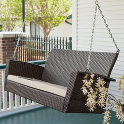 Coral Coast - Coral Coast Soho Wicker Porch Swing with Free Cushion Multicolor - CW3753SP DARK - Shop for Porch Swings from Hayneedle.com! Take your warm evenings from so-so to so-fine with the Soho Wicker Porch Swing with Cushion. Crafted of all-weather resin wicker in a deep espresso color this porch swing is built to withstand anything nature throws its way. Featuring clean lines and a modern weave this design makes porch swings cool again. A neutral colored cushion is included for added comfort and this porch swing is pre-equipped with hanging hooks for easy mounting. A Y shaped chain is included. This porch swing is a great partner to the Modern Wicker Rocking Chair with Cushion.About Coral Coast What if when you closed your eyes you pictured yourself in your own backyard? Coral Coast has a collection of easygoing affordable outdoor accessories for your patio pool or backyard. The latest colors and styles mingle with true classics in weather-worthy fabrics and finished woods ready for relaxation. Make yours a life of leisure.