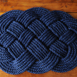 Navy Cotton Rope Bath Mat by O-Y-Knot - Why choose this beautiful handmade cotton rope rug? Well — wait for it — why knot? It's soft to the touch and can be made in any size you specify.