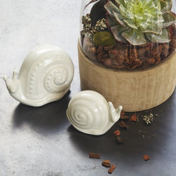 Ceramic Snail - A love for ceramic animals might be uniform across the board these days, but have you seen a ceramic snail yet? This modern little guy is perfect perched atop a stack of books on a side table or as a paperweight in the office.