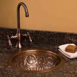 "14"" Sunflower Round Copper Sink - This copper sink is perfect as a prep sink for a kitchen or bar. It features an intricate scroll design with birds surrounding the centerpiece sunflower."