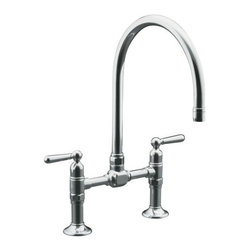 KOHLER - KOHLER K-7337-4-S HiRise Stainless Deck Mount Bridge Kitchen Faucet in Polished - KOHLER K-7337-4-S HiRise Stainless Deck Mount Bridge Kitchen Faucet in Polished StainlessThe HiRise Collection uniquely combines elements of vintage plumbing vernacular with the strength and beauty of solid stainless steel to create a truly sophisticated design that generates a level of comfort in both heritage and urban loft environments. A design that is both upscale and highly functional. The complete HiRise Collection includes product configurations for primary, secondary and entertainment sink applications. The deck-mount bridge faucet reintroduces a classic faucet design that not only creates a distinctive styling all of its own but also delivers great functionality with ease of maintenance and clean-up.