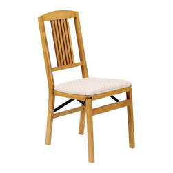 Stakmore - Simple Mission Folding Chair in Warm Oak Fini - Artful, comfortable, classic - this pair of chairs give you plenty of options. Each chair has Mission-style back slats and a warm oak finish. They also have padded and upholstered seats and fold when not in use, allowing easy transport and storage possibilities. Set of 2. Six vertical slats coming down from an arched top rail. Steel folding mechanism. Padded upholstered seat. Folds up to 7 in. deep for storage. Made from solid hardwood. No assembly required. 19.25 in. W x 16.25 in. D x 34 in. H. Seat height: 18.75 in.