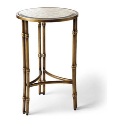 Frontgate - Oxford Accent Table - Vintage appeal at an exceptional value. Works beautifully with an array of sofa choices. Three half-moon stretchers ornament the base. Base crafted of metal; glass top. Equally at home in traditional and modern décor. With a bamboo design adorning its legs, the Oxford Round Accent Table projects tropical style while remaining svelte and symmetrical. Antiqued-brass finish gives a warm glow to the metal table, and an antiquing effect adds a vintage appeal to the mirrored top.  .  .  .  . Equally at home in traditional and modern decor . Adjustable rubber foot levelers help you securely position the table and protect flooring . Wipe base and legs clean with a soft cloth; clean glass top with a glass cleaner . Arrives assembled (mirrored top is packed in a separate box; just set it in place) .