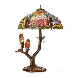 """Warehouse of Tiffany - Tiffany-style Warehouse of Tiffany Sarah Camille Table Lamp - This sweet Tiffany-style stained-glass table lamp gets top ratings for its ability to inspire """"oohs"""" and """"aahs"""" from whoever sees it. It features a tree-shaped lamp base that is adorned by two birds. The shade is made from 787 pieces of cut glass."""