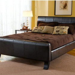 "Hillsdale - Brookland Sleigh Bed - Whether your bedroom dcor is contemporary or eclectic, the Brookland bed is a perfect fit. With a mature sleigh design, covered in Dark Brown Leather, it exudes a contemporary look with a touch of luxury. The headboard, footboard, and side rails are added for increased comfort and support. Features: -Dark brown leather. -Mature sleigh design. -Constructed with a hardwood frame. -Fully upholstered with bi-cast. -Box spring required. -Recommended care: Dust frequently using a clean, specially treated dusting cloth that will attract and hold dust particles. Do not use liquid or abrasive cleaners as they may damage the finish.. About Hillsdale House Furniture Located in Louisville, KY, Hillsdale House Furniture has produced an enormously popular collection of bedroom and accent furniture. Hillsdale House items are constructed of quality materials and offered at an affordable price. We are an authorized dealer of the full line of Hillsdale House furniture; if you can""t find a specific Hillsdale piece, give us a call!"