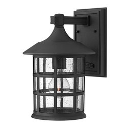 Hinkley - Freeport 1-Light Outdoor Wall Light Black - Freeport features a classic New England design in cast aluminum construction complemented by clear seedy bound glass. This wall sconce in a Black finish is a timeless, traditional style that will complement a variety of exteriors.