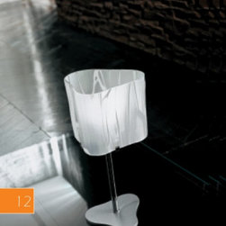 """Venezia table lamp LT 1/238 - The Venezia table lamp has been designed by Cierre Studio for Sillux. The Venezia series come with a chrome frame and an entirely handmade satin glass lampshade. Available in two colors. The Venezia adds elegance and uniqueness to any environment.  Product description:  The Venezia table lamp has been designed by Cierre Studio for Sillux. The Venezia series come with a chrome frame and an entirely handmade satin glass lampshade. Available in two colors. The Venezia adds elegance and uniqueness to any environment. Details:                         Manufacturer:             Sillux                            Design:                         Cierre Studio                                         Made in:            Italy                            Dimensions:                         Height: 15"""" (38 cm) X Length: 7"""" (18 cm)                                          Light bulb:             1 x 60W Incandescent                            Material             chrome, glass"""