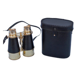 Handcrafted Nautical Decor - Solid Brass Binoculars w/ Leather Belt and Leather Case 6'' - These beautiful Hampton Nautical Admiral's Brass Binoculars with Leather Case 6'' will make anyone feel like a true navigator. With uniquely styled eye pieces that are better placed around the eye area for clearer vision, these binoculars have in-line prisms for improved field of view and have precision ground glass 1.75 inch (44 mm) diameter objective lenses. Focusing is accomplished using a knurled focusing knob on top of the binoculars. The binoculars have a leather strap and come with a handmade leather case.--------    Brass nautical binoculars--    --    Functional and decorative nautical decor--    20x magnification--    Easy focusing with knurled knob--    Leather strap and handmade leather case included for safe keeping--    Custom engraving/photo etching available; logos, pictures, and slogans can easily be put on any item. Typical custom order minimum for engraving is 100+ pieces. Minimum lead time to produce and engrave is 4+ weeks.--