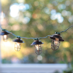 Indoor/Outdoor Electric Metal Lantern String Lights - The look of fishermen-style lights is so trendy now. I love these ones.