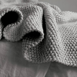 """Matteo - Matteo Knot Throw - The Knot Throw is a unique hand knit blanket produced by a collective in South America dedicated to improving the lives of women by sharing their artistry with the global market. Each throw is knitted by three to four women working together on one gorgeous, textured piece. 50"""" x 70""""; 100% cotton; Garment washed; Available in all Matteo colors except loomstate; Machine wash cold, line dry; Each throw is handcrafted in approximately 70 hours; Custom-dyed for each order; Any cancellations must be made within 24 hours of order placement"""