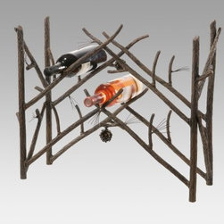 Pine Wine Rack - Looking for a wine rack that has a style as unique as yours? Then try our Pine Wine Rack. It has a cozy design and looks decorative on your countertop sideboard or table. Designed to hold 10 of your favorite bottles of wine it's crafted from hand-forged iron with a rustic pine branch design. The rack looks as though it's crafted from pine tree branches complete with pine cone details. And the natural black finish blends beautifully with any decor. It's a charming way to store wine and add distinction to your decor. Made in the USA. Dimensions: 24L x 8W x 20H inches. Weighs 29 pounds.About Stone County Ironworks.Stone County Ironworks creates heirloom hand-forged iron furniture. The company's blacksmiths use artistic ability and traditional tools like the hammer anvil and forge to create unique works of art naturally. For 30 years Stone County Ironworks has worked with designers and dreamers all over the country - sometimes forging through a completed drawing provided by a client and sometimes working only with an idea to discover and create just the right design. The company's quality workmanship that reflects the skill of the blacksmith continues to set it apart from other manufacturers.