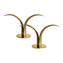 "Consigned Vintage - A Pair of Lily Shaped Ystad Metall Candlestick Holders - A pair of solid brass mid century lily shaped candle holders. Designed by Alenius Bjork for Scan Corporation and he also made idential pieces for Ystad Metall company.  Impressed marks on each base, """"Scan Corp or Ystad Metall and Made in Sweden."""