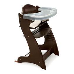 Badger Basket - Badger Basket Embassy Adjustable Wood High Chair with Tray - Espresso Dark Brown - Shop for Highchairs from Hayneedle.com! The Badger Basket Embassy Adjustable Wood High Chair with Tray - Espresso will serve the whole family! It's perfect for babies about 6 months old or who can sit unassisted but that's not all. It can be used as a chair for adults up to 175 pounds! Modern and sleek this high chair is constructed of poplar wood in a natural finish. It features a nylon cushion with a cotton/poly cover that can be tossed in the washing machine. The chair comes with two trays and a harness to keep baby secure. Its easily assembled with a simple Allen wrench and the seat is adjustable in height. Also included is a glide extension component to use with certain tables. The Badger Basket Embassy Adjustable Wood High Chair with Tray is a hip high chair for your hip little baby. Badger Basket CompanyFor over 65 years Badger Basket Company has been a premier manufacturer of baskets bassinets bassinet bedding changing tables doll furniture hampers toy boxes and more for infants babies and children. Badger Basket Company creates beautiful and comfortable products that are continually updated and refreshed bringing you exciting new styles and fashions that complement the nostalgic and traditional products in the Badger Basket line.