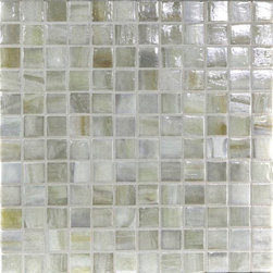 "Glass Tile Oasis - Smoke 1"" x 1"" Grey Pool Glossy & Iridescent Glass - Sheet size:  1.11 Sq. Ft.   Tile Size:  1"" x 1""   Tiles per sheet:  144    Tile thickness:  1/4""   Grout Joints:  1/8""   Recycled Components:  70%   Sheet Mount: Paper Face     Sold by the sheet    - This collection is evocative of the glass-like natural layered silica created by volcanic stone formations. With a nod to old world Venetian glassmakers  our mosaics are created using the same processes from molten silica; hand-poured  blending transparent and opaque colors and natural and opalescent finishes into a unique  luxurious glass designed to please the most discriminating eye. It is available in 14 dramatic color blends and two finishes  Glossy & Frosted. Each piece is hand-poured and unique  designed with a certain amount of variation and variegation of color  tone  texture and shade for a distinctive appearance. Our hand-made process incorporates creases  wrinkles  waves  bubbles and other surface effects indicative of hand-made glass  all designed to capture light and enhance the final beauty of the project."