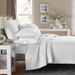 Real Simple - Real Simple Dune Coverlet in White - This classic Real Simple Dune coverlet adds a touch of easy, elegant charm to your bedroom with its clean design and tasteful available color selection. Made of sateen cotton, this coverlet feels like silk against your skin for a luxurious night's rest.