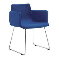 Pita Sport Chair By Cappellini - This contemporary chair just glides. The slender leg base provides ample support for the cushy and colorful seat. I'd love to see four of these used around a round eat-in kitchen table, perhaps in 2 pairs of 2 colors, or I'd use a leather-upholstered one as an occasional chair in a lounge or family room.