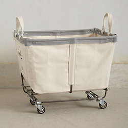 Anthropologie - Mobile Canvas Bin - Oh, every house needs this charming canvas bin. Use it for holding laundry or for keeping the children's toys under control.