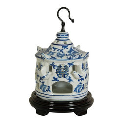 "Oriental Furniture - 11"" Floral Blue & White Porcelain Bird Cage - A delicate but durable porcelain decorative bird cage featuring a Ming blue and white floral design and protruding porcelain birds. Symbolic Shou medallion is stamped into the front above the door. Display hung from the ceiling or an ornament hanger, or as a curio on a shelf unit or breakfront."