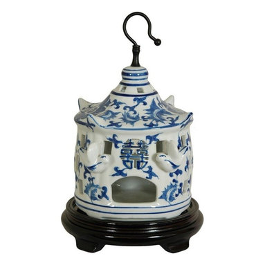 """Oriental Furniture - 11"""" Floral Blue and White Porcelain Bird Cage - A delicate but durable porcelain decorative bird cage featuring a Ming blue and white floral design and protruding porcelain birds. Symbolic Shou medallion is stamped into the front above the door. Display hung from the ceiling or an ornament hanger, or as a curio on a shelf unit or breakfront."""