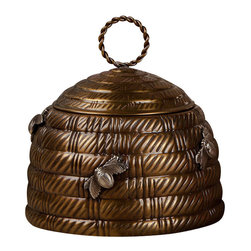Antique Brass Bee Box - Traditional motifs reinvented with the unabashed charm of transitional decor , the Antique Brass Bee Box is a lidded metal pot formed into the iconic domed shape of a beehive attended by a few plump worker bees that hover over the walls. The lid of the textured hive can be lifted with an airy braided-ring handle. This neat, imaginative accent is especially perfect for the nursery or the kitchen.