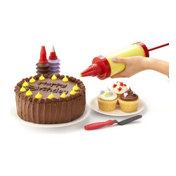 "Kuhn Rikon - Kuhn Rikon Pastry Decorating Set - Decorate Store Bought and ""From Scratch"" Desserts - Celebrate life's great occasions. Decorate desserts like a pro.  Features:  Large pastry gun can frost an entire cake without refilling   Tips create ribbons, stars, flowers, lettering and more   Flexible spatula makes smooth frosting easy   Use squeezable bottles for colorful accents and lettering   Set includes:   Pastry Gun   12 Plastic Tips   2 Stainless Tips   2 Decorating Bottles   1 Frosting Spatula   Suggested Uses:  Make professional-looking cakes, cookies and cupcakes   Pastry gun shapes meringue cookies and squeeze bottle drizzles them with chocolate   Create dozens of colorful effects - lettering, leaves, stars and more   Fill cupcakes, eclairs and cream puffs quickly and easily"