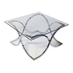 Leonardo Cocktail Table - The Leonardo occasional tables delivers an unsurpassed level of sophistication and elegance to your living room. The chrome base is artfully designed with fanciful curves that come together in quintessential balance. The pointed corners awaken the imagination, as they seamlessly glide into ocean wave-like formations. The hollowed base center can easily frame a lovely center piece or statue. Topped with gleaming tempered glass, even a soft light will allow this immaculate table collection to add an extra sparkle of illumination to any size room. You are sure to receive endless compliments on this exceptional conversation piece. Photo: Jerome's Furniture