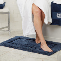 Frontgate - Resort Cotton Bath Rug - Made of 100% combed, long-staple cotton yarns. Cotton bath rugs acquire a more lush texture with every wash. Custom-dyed for vibrant, non-fading hues. Latex-treated back provides secure footing. Machine-washable. Our skid-resistant Resort Cotton Bath Rugs provide cloud-like softness as you step out of the shower. Crafted from the same heavenly soft and substantial long-staple cotton as our Resort Towels, these bath rugs are woven to a superbly soft, high pile that is offset by a band of low loops.  .  .  .  .  . Made in India.