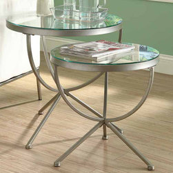 Monarch - Satin Silver 2Pcs Nesting Table Set with Tempered Glass - With its smooth edges and tempered glass tops, this 2 piece nesting table set gives a contemporary look to any room. Its chic satin silver metal base with curved legs provides sturdy support as well as a modern look. Use this multi- functional set as end tables, lamp tables, decorative display tables, or simply as accent pieces.