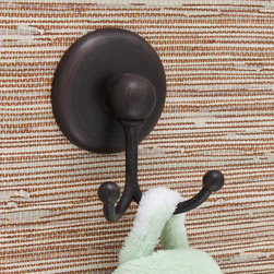 Freesia Double Robe Hook - Featuring soft curves and a unique form, the Freesia Collection Double Robe Hook will add a modern elegance to your bathroom. Add this piece and other items from the Freesia Collection to complete your bathroom accessory set.