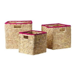 Serena & Lily - Nantucket Bins  Fuchsia (Set of 3) - High-def color turns simple baskets into statement storage. Chunky seagrass coils are wrapped by hand in dyed palm leaves and then tightly wound around and around to create the super-sturdy shape. The natural texture creates slight variations in color that make each basket all the more unique. Designed to nest if need be, all three sizes have cutout handles. The medium-sized bin fits perfectly in our Lark Shelf and our Campaign Storage Bench.