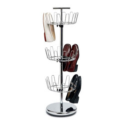 Revolving 3 Tier Shoe Tree - 2131 - Shop for Closet from Hayneedle.com! Shoe storage is one of the greatest closet challenges. Tackle it head-on with the Revolving 3 Tier Shoe Tree. Constructed of durable commercial-grade steel in your choice of powder-coated finishes this unit spins to allow full access without taking up much space. The weighted bottom prevents toppling and the handle makes it easy to transport wherever you need it. This tree holds up to 18 pairs of shoes and has three wire tiers that are adjustable to fit your shoes. Some assembly is required.