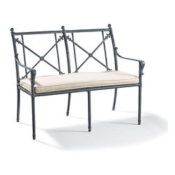 Frontgate - Campaign Outdoor Bench with Cushion, Patio Furniture - Solid cast aluminum frame and ornamentation. Hand-applied verde patina finish comes with a three-year warranty. Generously proportioned seating. Seating arrives with plush, all-weather seat cushions. Cushions are constructed of a high-resiliency foam core with soft polyester wrap. Our Campaign Bench beautifully blends cast-iron ornamentation and campaign styling in durable, solid cast aluminum. The frame's strong, linear form is tempered with classic fleur-de-lis and rosette decoration. The look is perfected by our proprietary, 3-step finish, which has the desirable patina of iron that's been aged for 30 years. Part of the Campaign Collection.  .  .  .  .  . Finished with 100% solution dyed Sunbrella fabric covers that resist mold, mildew and fading . Imported.