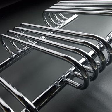 Hudson Reed - Voco Designer Chrome Towel Radiator Rail 35.4 inch x 19.7 inch - This compact Ladder Style Heated Towel Rail has a high quality chrome plate finish and gives a heat output of 313 Watts (1,067 BTUs), enough to dry your towels and heat a small bathroom or cloakroom. With 18 horizontal polished chrome rungs, this designer radiator is the stunning focal point of any modern bathroom, shower room, cloakroom or ensuite, and provides ample room for drying towels and small items of clothing.Supplied complete with a fixing pack for wall mounting, and suitable for all household heating systems, the 35.4 x 19.7 Heated Bathroom Towel Rail connects to your heating system via the radiator valves included (please choose either straight or angled). Chrome Curved Bathroom Heated Towel Radiator Rail 35.4 x 19.7 Details:  Dimensions: (H x W x D) 35.4 x 19.7 x 15.1   Output: 313 Watts (1,067 BTUs)   Number of cross-bars: 18, divided into 3 sections of 4, 4, 10,   Pipe Centres: 11.4   Fixing Pack Included   Max projection, using wall mounting kit provided: 6.5   Suitable for bathroom, cloakroom, kitchen etc.   Expertly plated with high quality 62.5 micron chrome on copper plated mild steel, with swagged oven brazed joints.   Tested to BS EN442 - 10 bar maximum working pressure   5 Year Guarantee (12 months for surface finish)   Please note:Radiator valves included, please choose either straight or angled radiator valves  Buy now, to transform your bathroom, at an affordable price. Please Note: Our radiators are designed for forced circulation closed loop systems only. They are not compatible with open loop, gravity hot water or steam systems.
