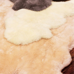 Shearling Rug - Natural Australian and New Zealand sheepskin pelts are lightly sheared for a plush, uniform depth and sewn together, retaining the quirky, organic shapes. Suede leather backing.