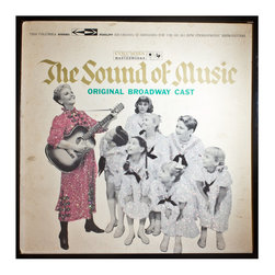 """Glittered Sound of Music Album - Glittered record album. Album is framed in a black 12x12"""" square frame with front and back cover and clips holding the record in place on the back. Album covers are original vintage covers."""