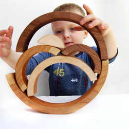 Brainbow Wooden Toy by Little Sapling Toys - This is not only a great toy, but I see this as a fantastic modern art piece that would stand out in any modern home. I would place this at the bottom of a bookshelf with plenty of breathing room for kiddos to get creative and unleash their inner David Smith.