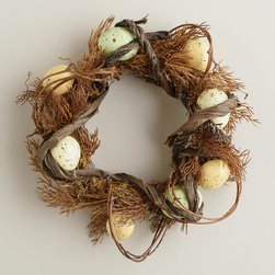 Egg Nest Candle Ring - Anything to do with candles in decor is speaking my love language. Place a simple white pillar candle in the center of this wreath for the perfect centerpiece. You can always decorate in a set of three with these as well.