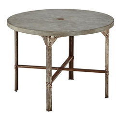 HomeStyles - Urban Outdoor Round Dining Table - Clear coated rusted aged metal. Fake rivet heads on table base. Molded concrete over a light weight core table top. Dimensions: 41 in. W X  41 in. D X  30 in. HStrength meets beauty in this urban industrial design.  The Urban Outdoor collection by Home Styles displays unrefined beauty in the midst of aged metal rust sealed with a clear coat. The Round Dining Table is constructed of molded concrete over a light weight core and clear coated rusted aged metal. Fake rivet heads on base complete this industrialized look. Size: 41w 41d 30h