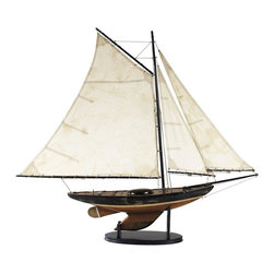Authentic Models - Newport Sloop Model Yacht - Made of Wood, and Cotton Sails. Black, and Natural Finish. 39 in. W x 5.7 in. D x 33.9 in. HThis boat invites one to tell the story of how it was found at the Marché Biro, avenue Michelet in Paris. It was the deep distressed black, white and red patina that attracted instantly. And the fact that the old gentleman confided that it was purchased only recently at Drouot, the one auction house in Paris. Better catch your breath; you might get carried away since it still has its bronze name plaque in place somewhere. Astounding in its very own way.