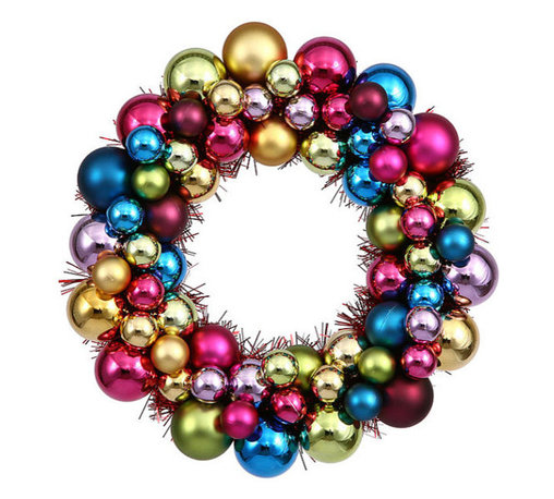 Shatterproof Christmas Ball Ornament Wreath by Jessica Strayer Design - This year I am going bold with color and creating a more whimsical feel. This ornament wreath is the perfect addition to any room at the holidays if you are not shying away from color.