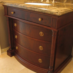 Glazed Walnut Vanity - Custom curved drawer fronts were made in book matched walnut veneer. Custom turned details frame the drawer fronts and allow the piece to have that free standing look. This design was based on an antique dresser we saw.
