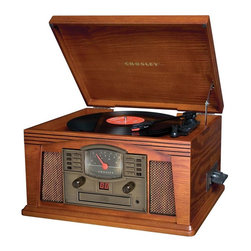 Crosley Radio - Lancaster Entertainment Center - Belt Driven Turntable Mechanism. Plays 3 Speeds - 33 1/3, 45 And 78 RPM Records. Plays 7, 10 and 12 inch records. Diamond Stylus Needle. CD Player. Programmable 20-Track Memory. LED Display. Portable Audio Ready-Simply Plug In Your Portable Audio Device Or MP3 Player. Repeat Play. Cassette Deck. AM/FM Radio. Airplane Tuning Dial. Analog Tuner. Dynamic Full Range Stereo Speakers. Function Select. Auxiliary Input. Headphone JackLancaster Pennsylvania is the oldest inland city in the U.S. and originally settled in 1718. It is well known for its architectural heritage featuring clean lines and simple designs. Just like a great architectural masterpiece, the Crosley Lancaster Entertainment Center features clean and sophisticated lines that are nicely detailed by open face grillwork and an authentic airplane-style dial. Lift the hinged lid to reveal a 3 speed record player that plays your 33 1/3, 45 and 78 RPM records. After listening to your old vinyls, sit back and relax to the AM/FM radio or the more modern CD player. The Lancaster's classic design and functionality make it a simple solution for any music lover.
