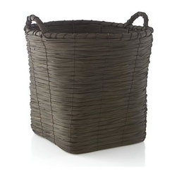 Wallman Large Basket - Handwoven basket is stained rich brown to bring out the organic texture of natural fiber. Tall round basket tapers to a sturdy square base, ready to receive towels, toys and household clutter.