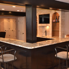 Traditional Basement by Remodeling and Painting Experts Inc.